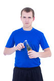 Young man opening the bottle of beer isolated on white Royalty Free Stock Image