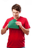 Young man opening letter Stock Images