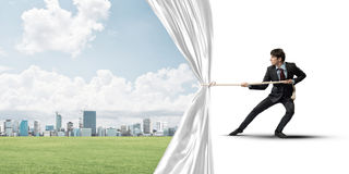 Free Young Man Opening White Curtain And Presenting Modern City Landscape Stock Photo - 97655950