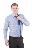 Young man opens his necktie Royalty Free Stock Photo