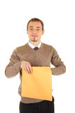 Young man opens a post package Royalty Free Stock Image