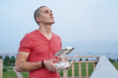 Young man operating a drone remote control console Stock Photos