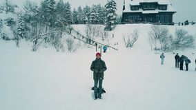Young man operating a drone on vacation, winter scenery view from UAV camera Royalty Free Stock Photos