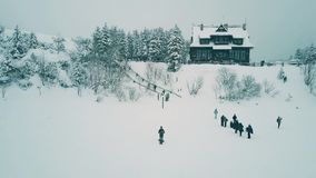 Young man operating a drone on vacation, winter scenery view from UAV camera. Young man operating a drone on vacation stock footage