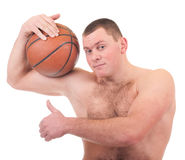 Young man with orange basket ball Stock Image