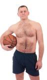 Young man with orange basket ball Stock Photos