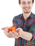 Young man with orange gift box Stock Photography