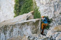 Man climbs a rock royalty free stock photos