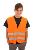 Young man in orange protective waistcoat Royalty Free Stock Image