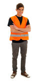 Young man in orange protective waistcoat Royalty Free Stock Photo