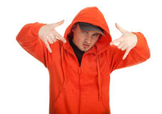Young man in orange sweatshirt Stock Images