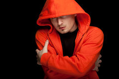 Young man in orange sweatshirt Stock Photography