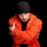 Young man in orange sweatshirt Stock Photo