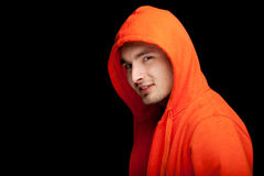 Young man in orange sweatshirt Stock Photos