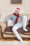 The young man ornate with Christmas decorations and red hat royalty free stock images