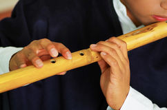 Young man from Otavalo, Ecuador, playing the quena flute Stock Photo