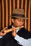 Young man from Otavalo, Ecuador, playing the quena flute Stock Photos