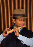 Young man from Otavalo, Ecuador, playing the quena flute Royalty Free Stock Images