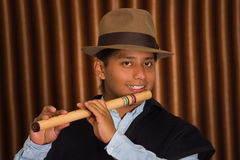 Young man from Otavalo, Ecuador, playing the quena flute Stock Photography