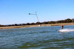 Young man out for a wakeboard at the Perth wake park Stock Photo