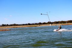 Young man out for a wakeboard at the Perth wake park Stock Photos