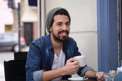 Young man at an outdoor cafe. Royalty Free Stock Images