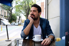 Young man at an outdoor cafe. Stock Image