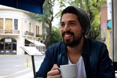 Young man at an outdoor cafe. Royalty Free Stock Photography