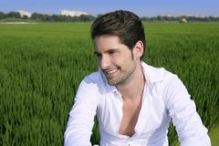 Young man outdoor happy in green meadow Royalty Free Stock Image