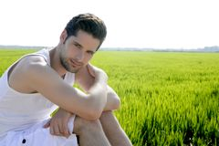 Young man outdoor happy in green meadow Stock Photos