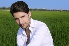 Young man outdoor happy in green meadow Royalty Free Stock Images