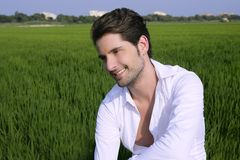 Young man outdoor happy in green meadow Royalty Free Stock Photo