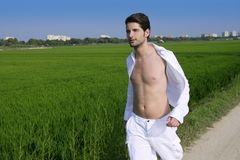 Young man outdoor running in meadow Royalty Free Stock Images