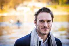 Young man outdoor in winter by lake or river Royalty Free Stock Image