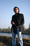 Young man outdoors. Young handsome serious man outdoors Royalty Free Stock Images