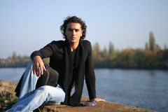 Young man outdoors. Young handsome serious man outdoors Stock Image