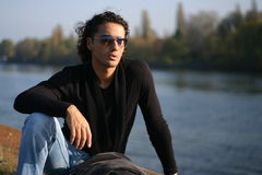 Young man outdoors. Young handsome serious man outdoors Royalty Free Stock Image