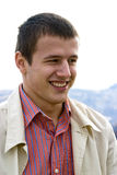 Young Man Outdoors. An outdoor portrait of a handsome, casually dressed young man with short hair and a warm smile Stock Images
