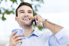 Young man outdoors with coffee Royalty Free Stock Images