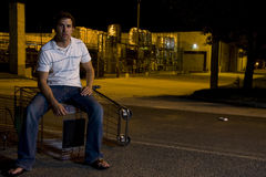 Young Man Outdoors at Night. Young white male outside at night with a shopping cart Stock Images