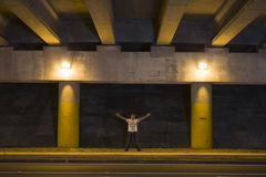 Young Man Outdoors at Night. Turn lane under an overpass at night Royalty Free Stock Photo