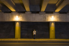 Young Man Outdoors at Night. Turn lane under an overpass at night Royalty Free Stock Photos