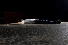 Young Man Outdoors at Night. Young white male outside at night in a dark parking lot Royalty Free Stock Photo