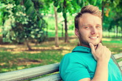 Young man outdoors with park background royalty free stock image