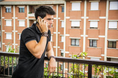 Young man outdoors talking on cell phone Royalty Free Stock Photos