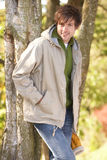 Young Man Outdoors Walking In Autumn Woodland Royalty Free Stock Photo