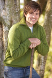 Young Man Outdoors Walking In Autumn Woodland Stock Photography