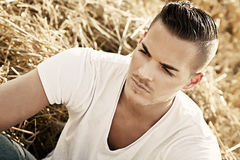 Young man outdoors in white casual shir Royalty Free Stock Photos