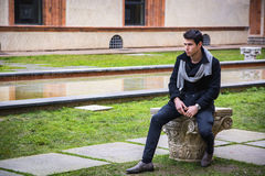 Young Man Outside the Building Looking Away to Royalty Free Stock Photos