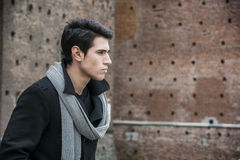 Young Man Outside the Building Looking to Right Royalty Free Stock Image